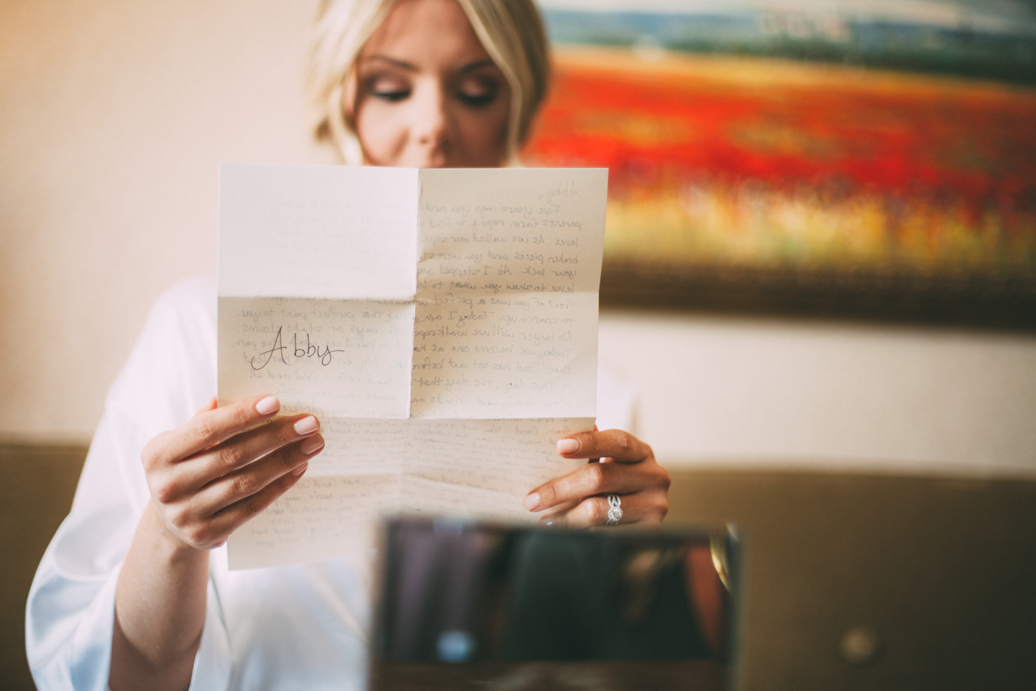 Bride reads a letter from the groom