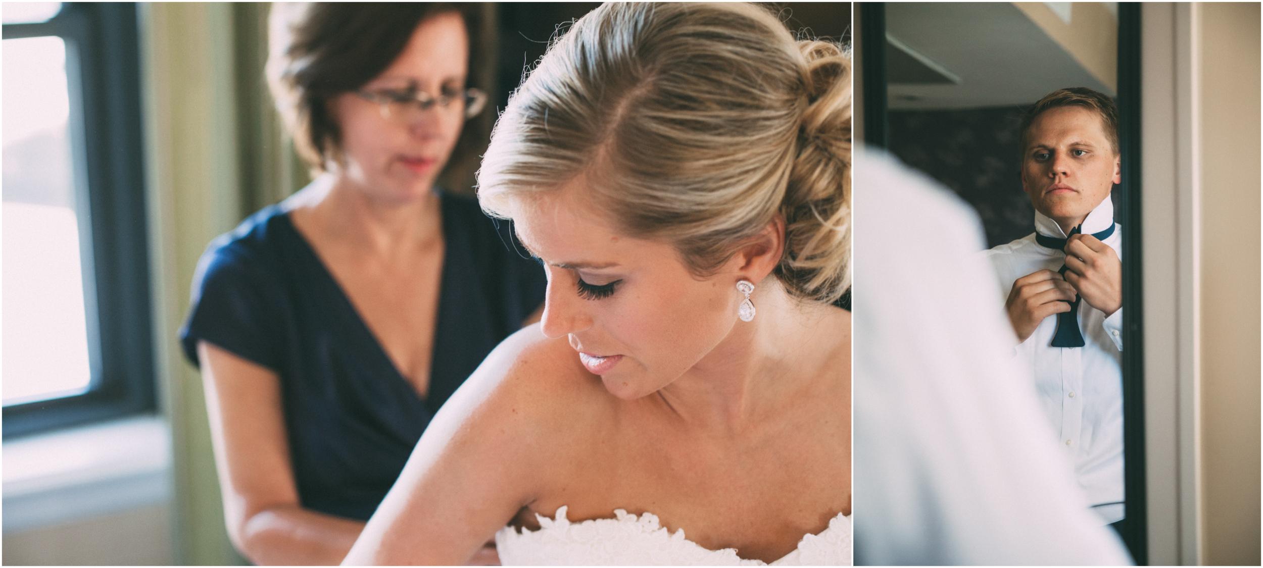Mother helps bride into dress - Groom adjusts tie in mirror