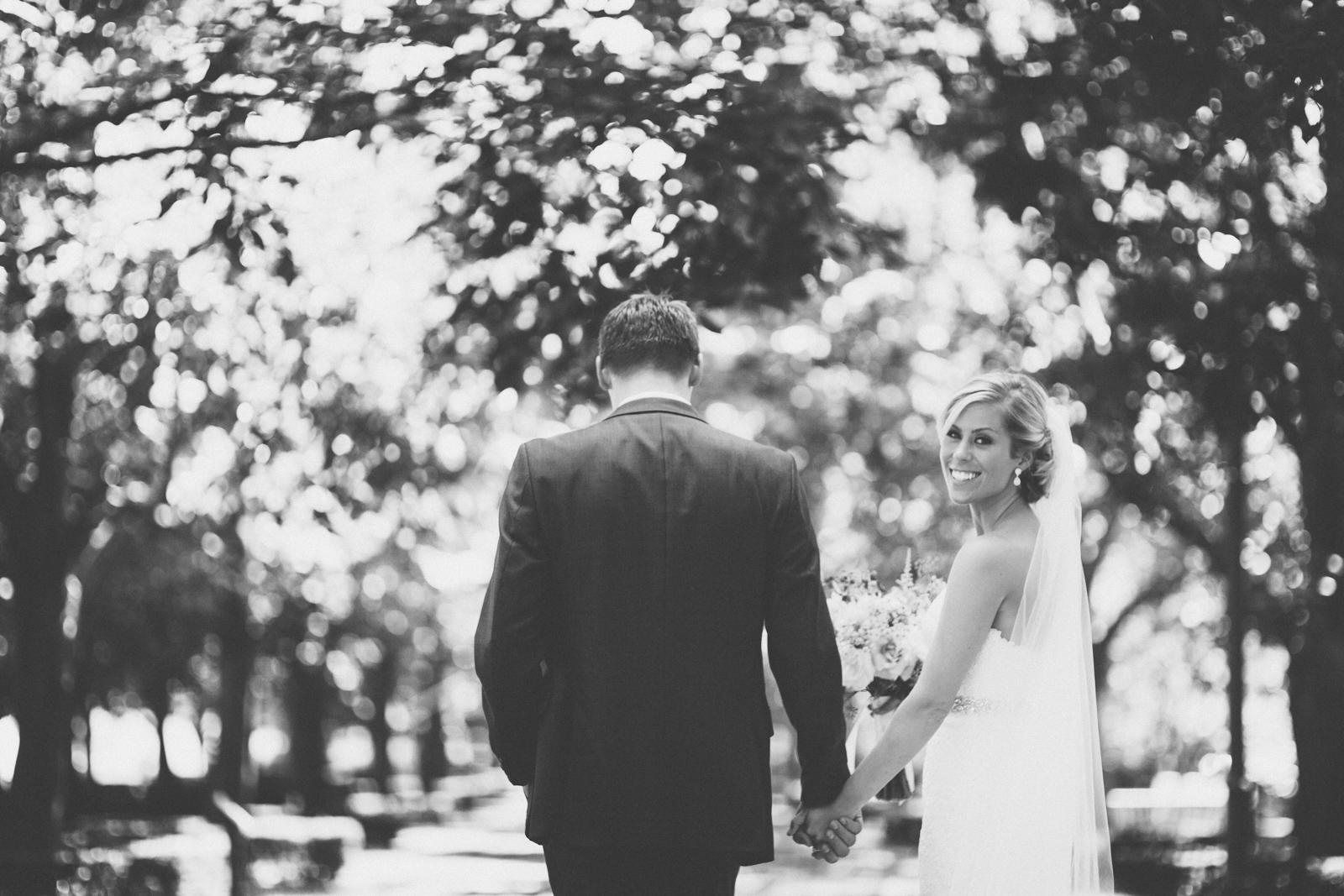 Bride and groom walking - bride looking back