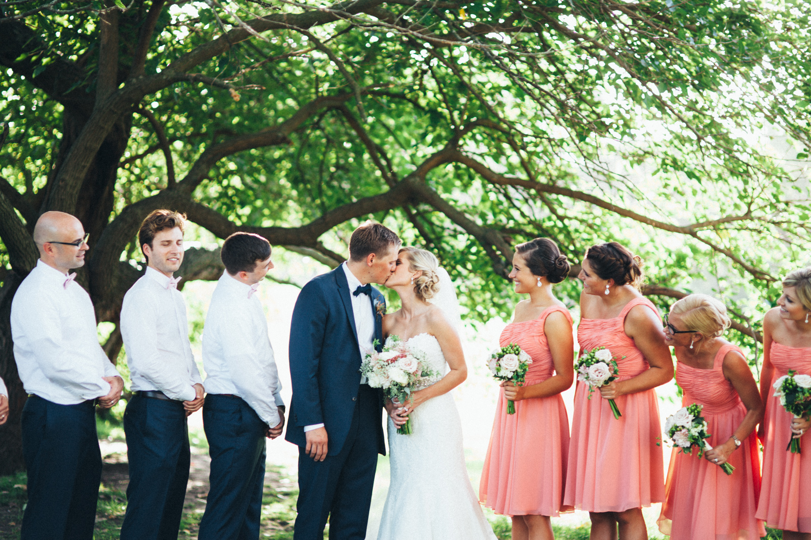 Bride and groom and wedding party in the country