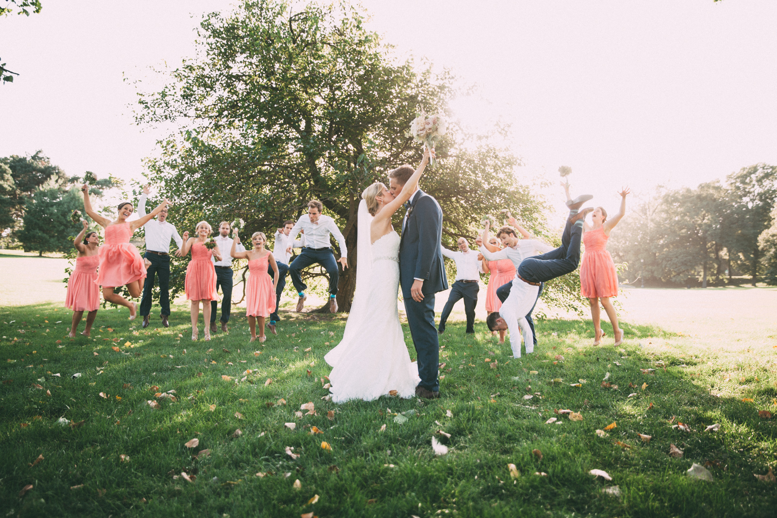 Bride and groom kiss while wedding party goes nuts