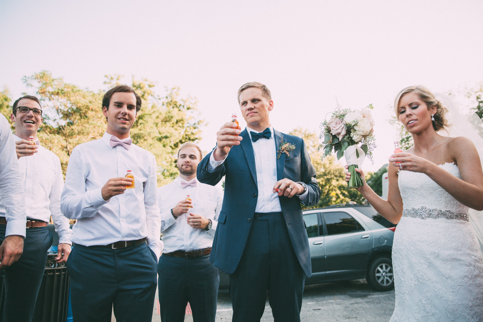 Bride and groom impromptu toast with wedding party