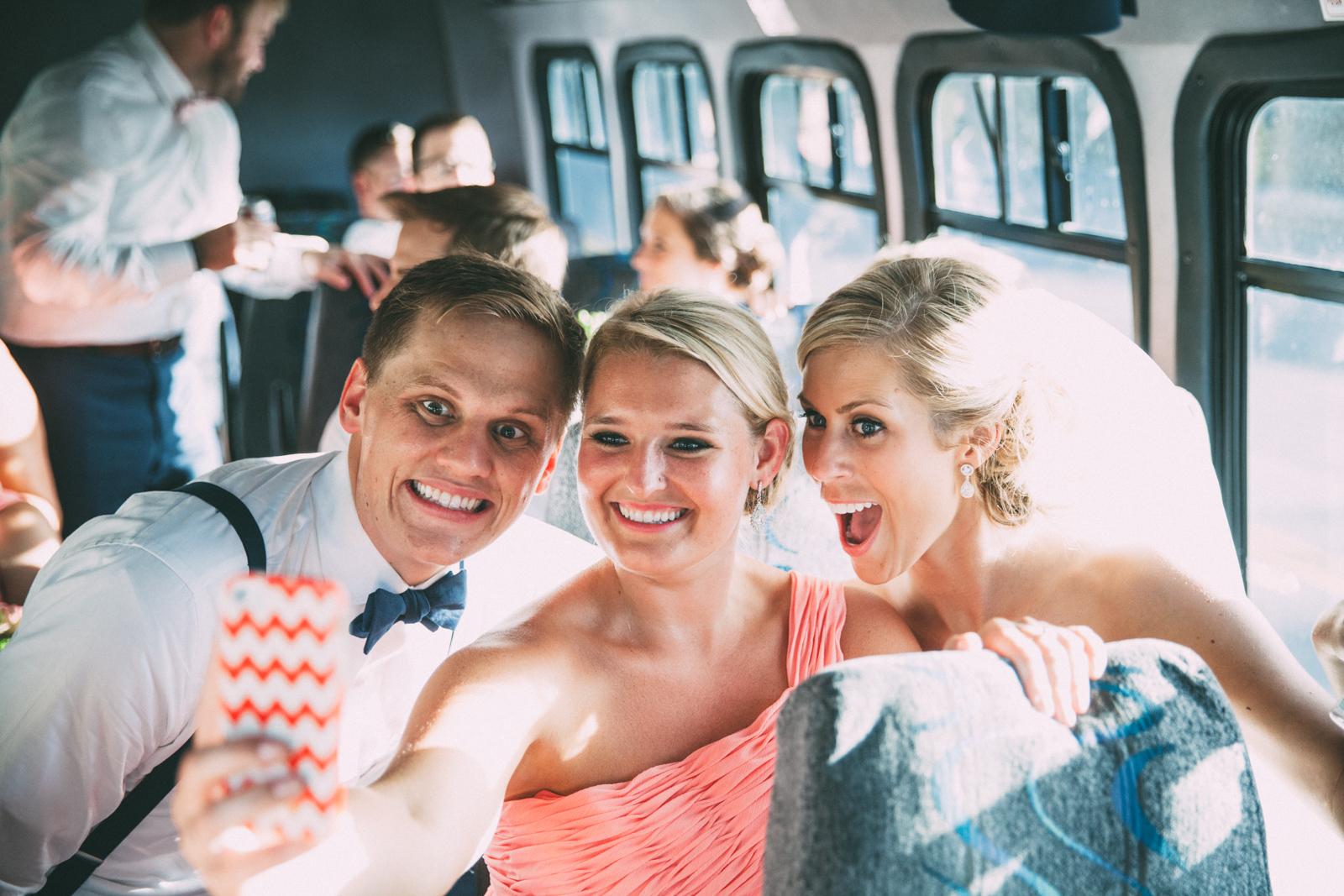 Bride and groom selfie with bridesmaid