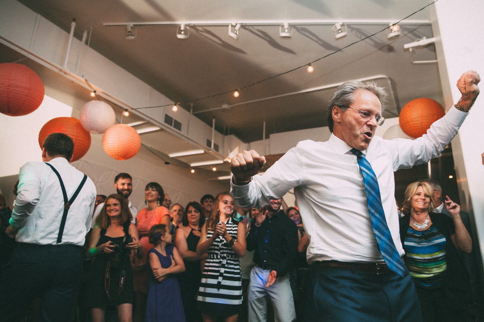 Father of groom dancing at his wedding reception in Kansas City
