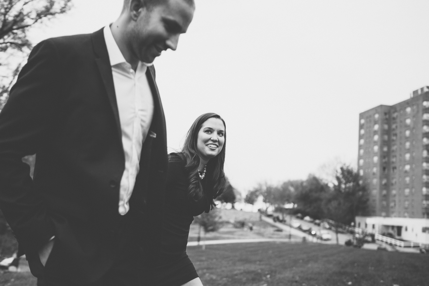 Engaged couple walking hand in hand in a Kansas City park