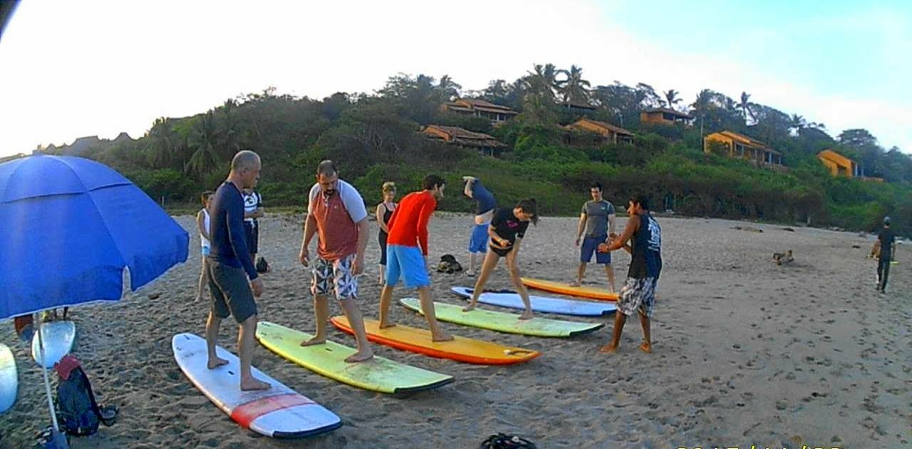 The crew learning to surf