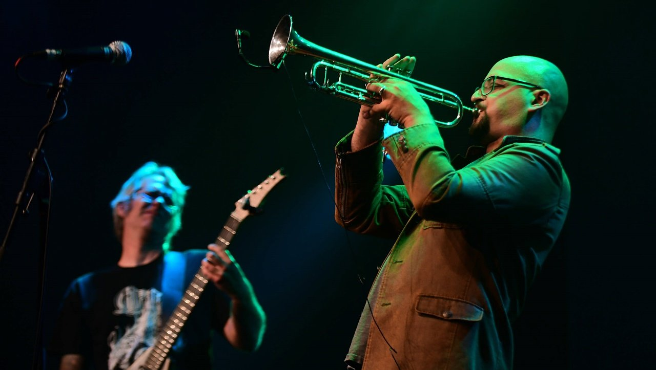 Jake Vossler (guitar) and Daniel Rosenboom (trumpet) performing with Burning Ghosts on the Main Stage at  Jazzfestival Saalfelden , Austria, on August 27, 2016. Photograph by Heinz Bayer.