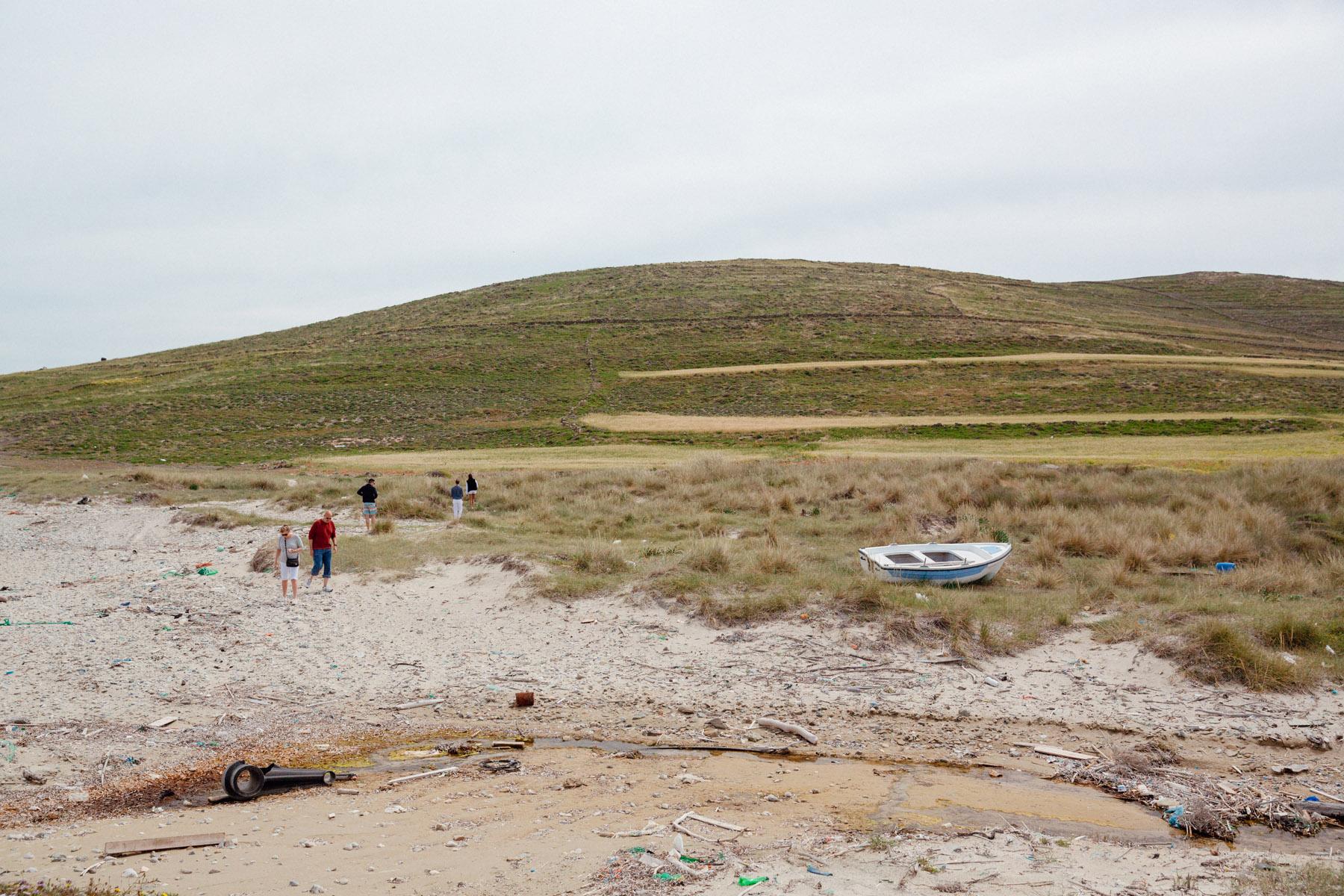 The uninhabited island of Rineia, with a beach full of trash and gigantic snake skulls