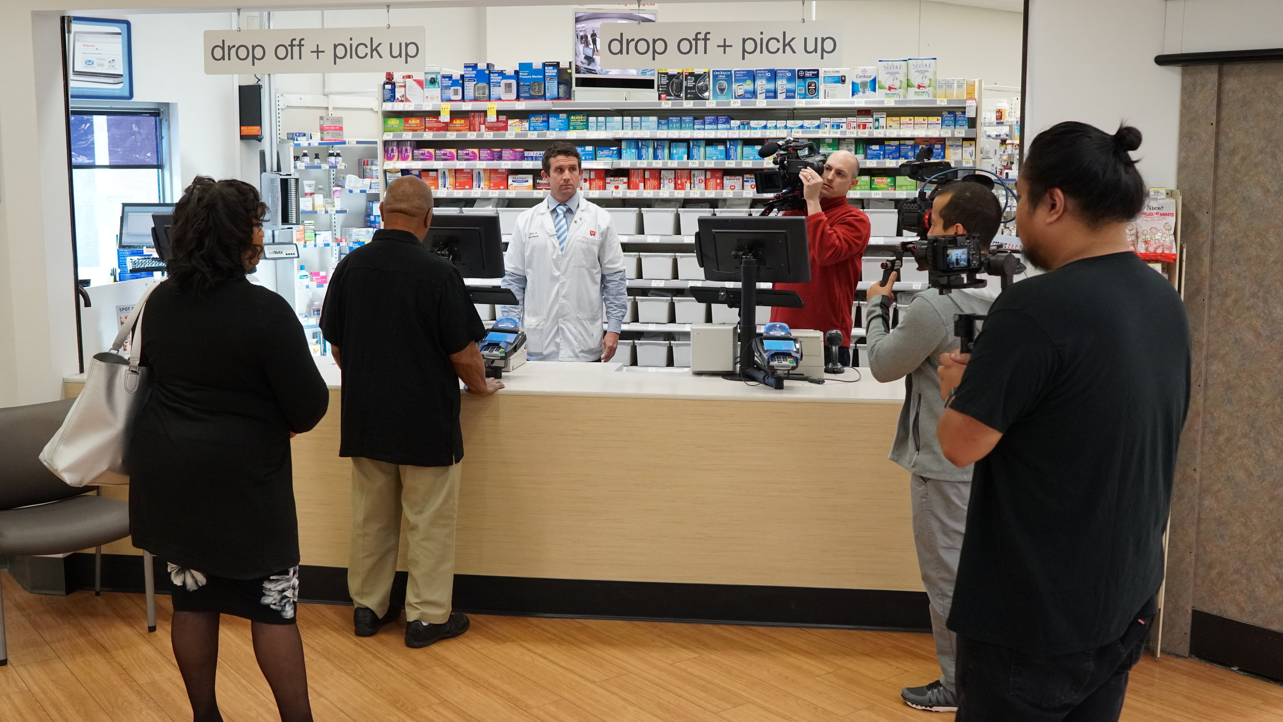 Lifetime Media crew on the set of scene 1 for real-time stroke simulation @ Walgreens Pharmacy w/ actor Mr. Lee as stroke victim.