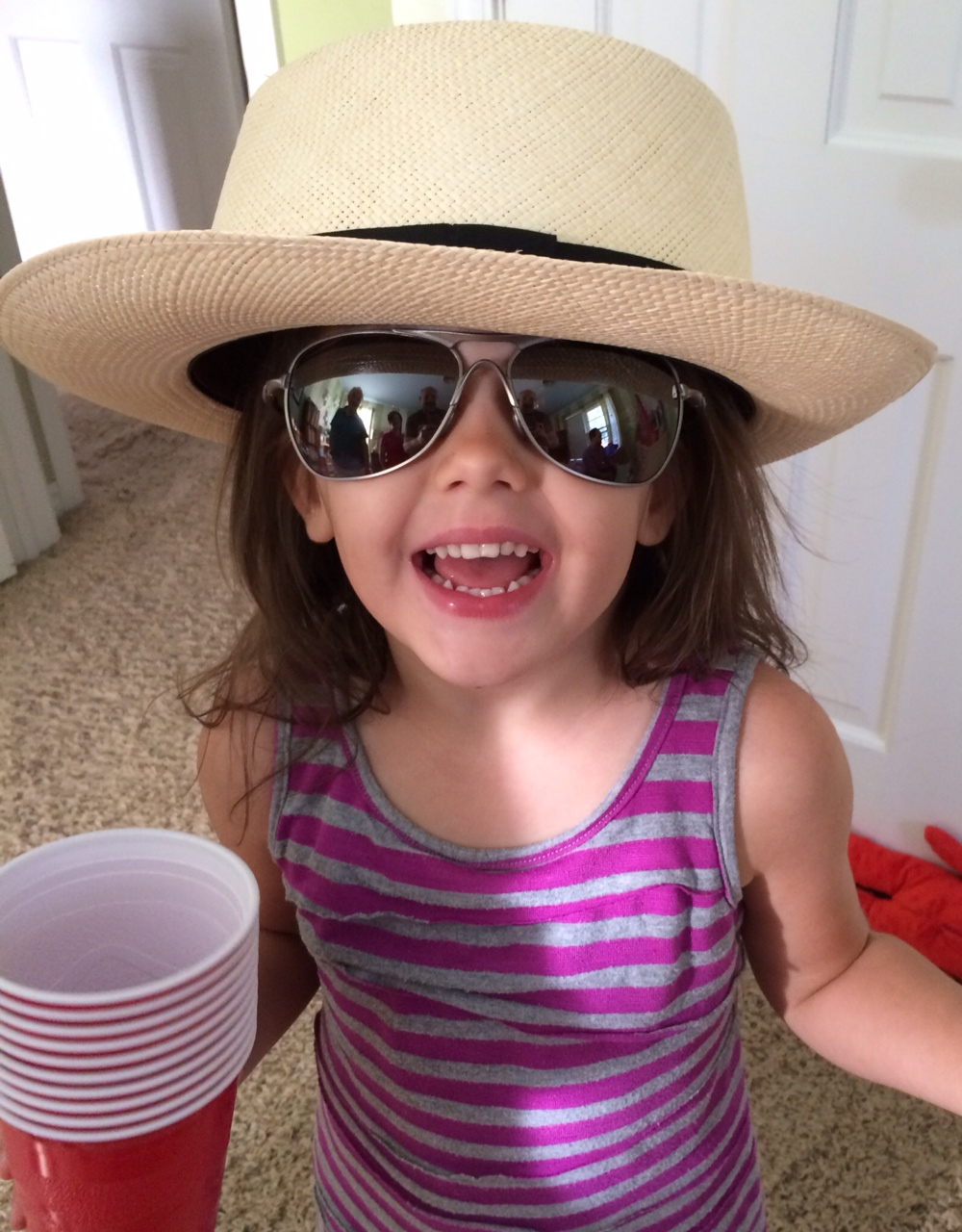 Our oldest Grand-Girl, Karlee in Pops' hat and her Uncle Kyle's shades. The red cups? All hers.