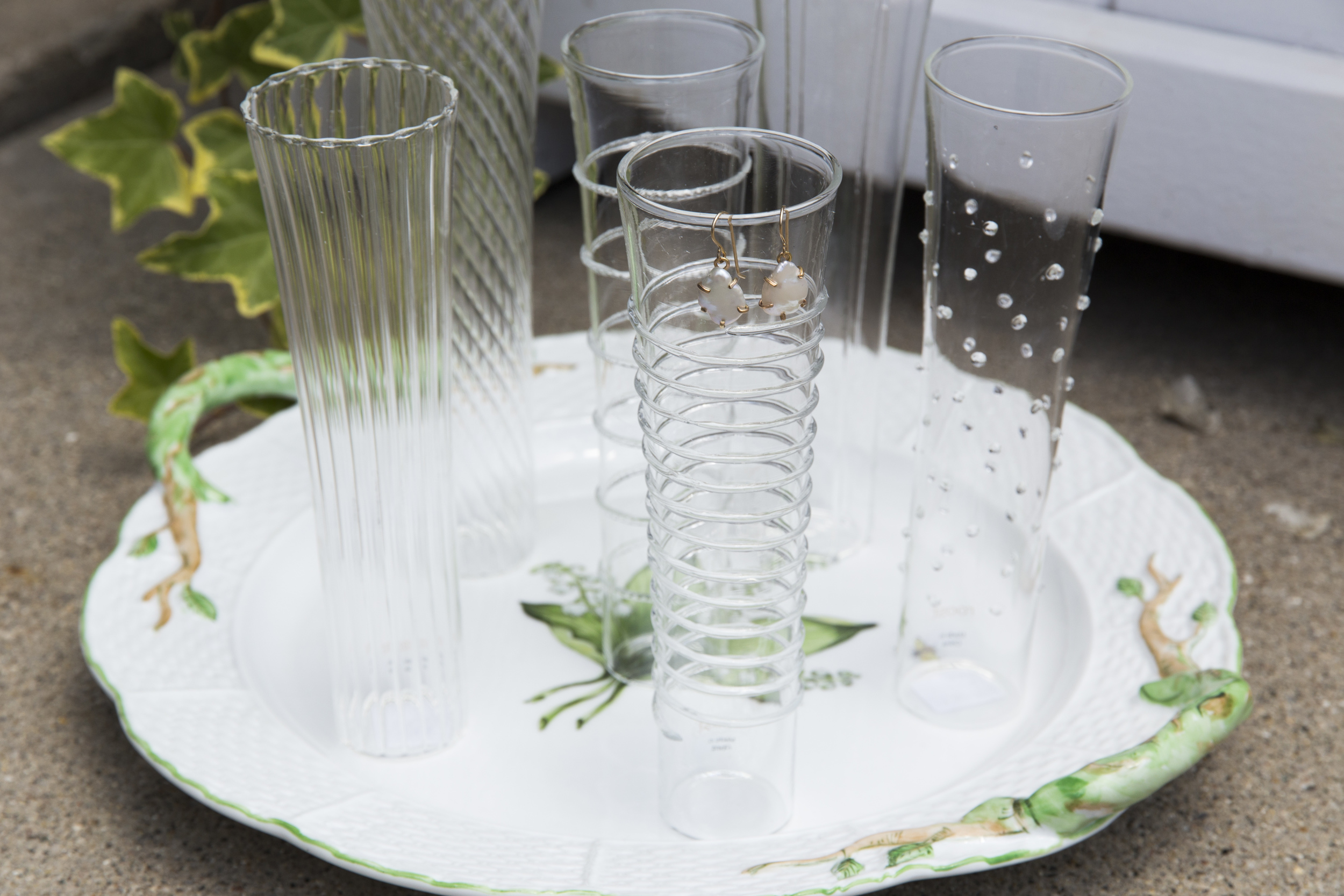 Every couple will treasure (and use) gorgeous serving pieces for decades to come - especially when the pieces feature the flowers from the couple's ceremony. We simply adore this sweet, mis-matched set of unique champagne flutes.