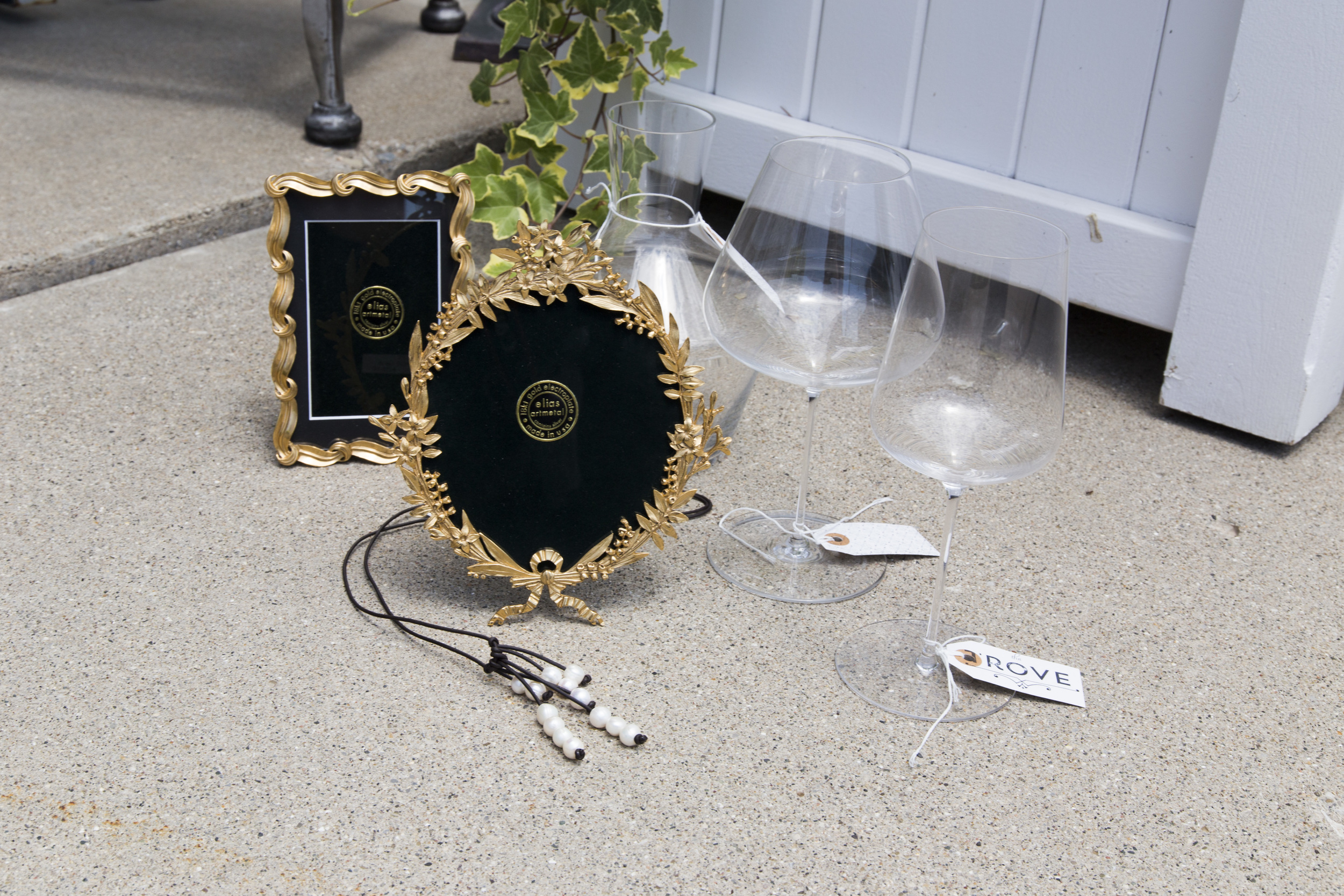 An elegant picture frame is a tasteful gift for parents of the happy couple. And in our experience, quality wine glasses are always appreciated.