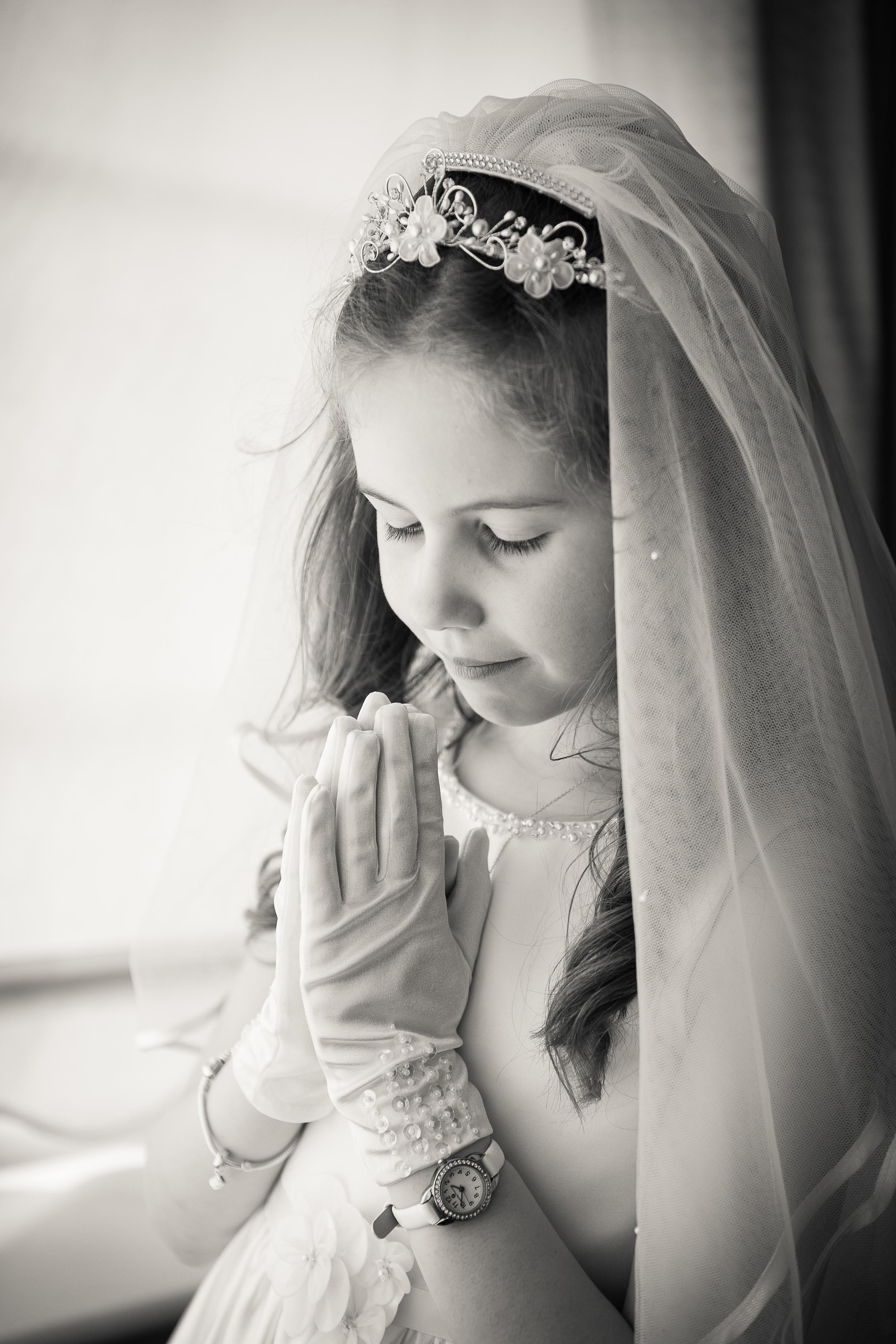 Sophie in prayer portrait at home
