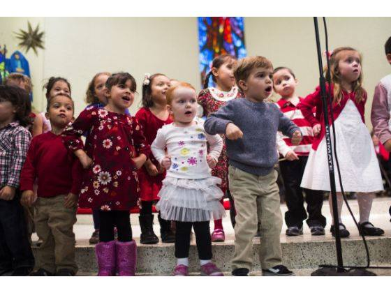 Preschoolers perform during the Christmas concert in a photo published in the Orange County Register.