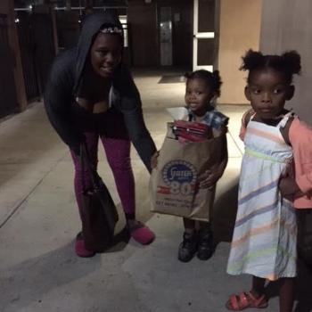 Children taking home a Thanksgiving dinner