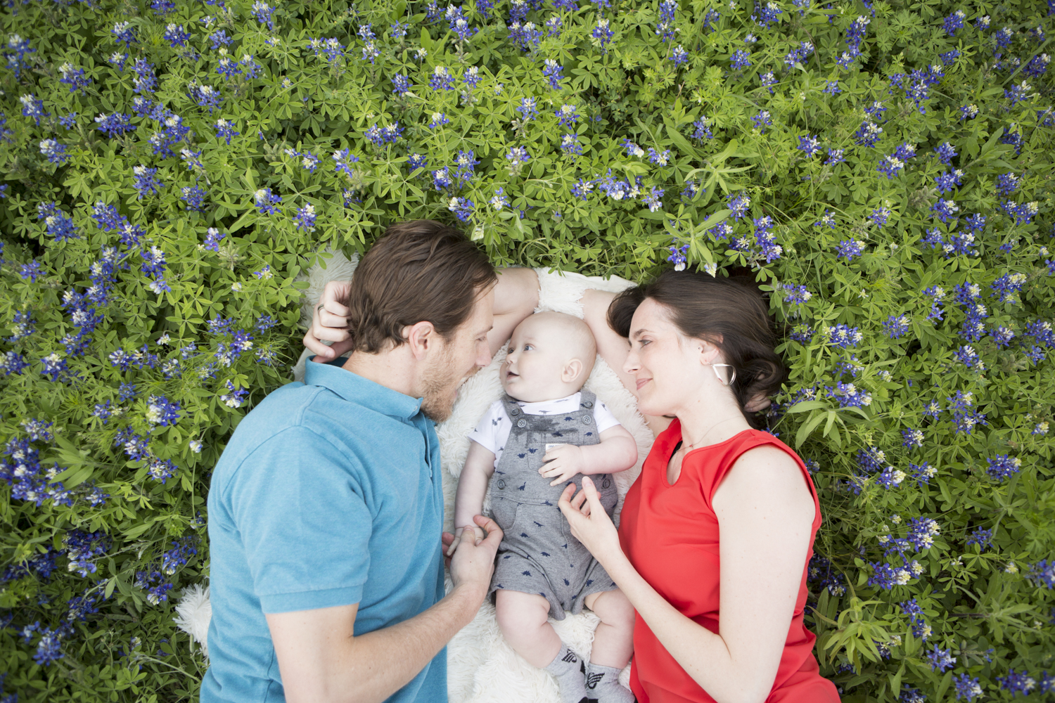 Besides the beautiful colors and people in this image, all I see is connection, wonder, and love. I can feel the adoration that these parents have for their baby in this image and I can truly get a sense of the baby's wonder as he gazes into his dad's eyes. Definitely one of my favorites.