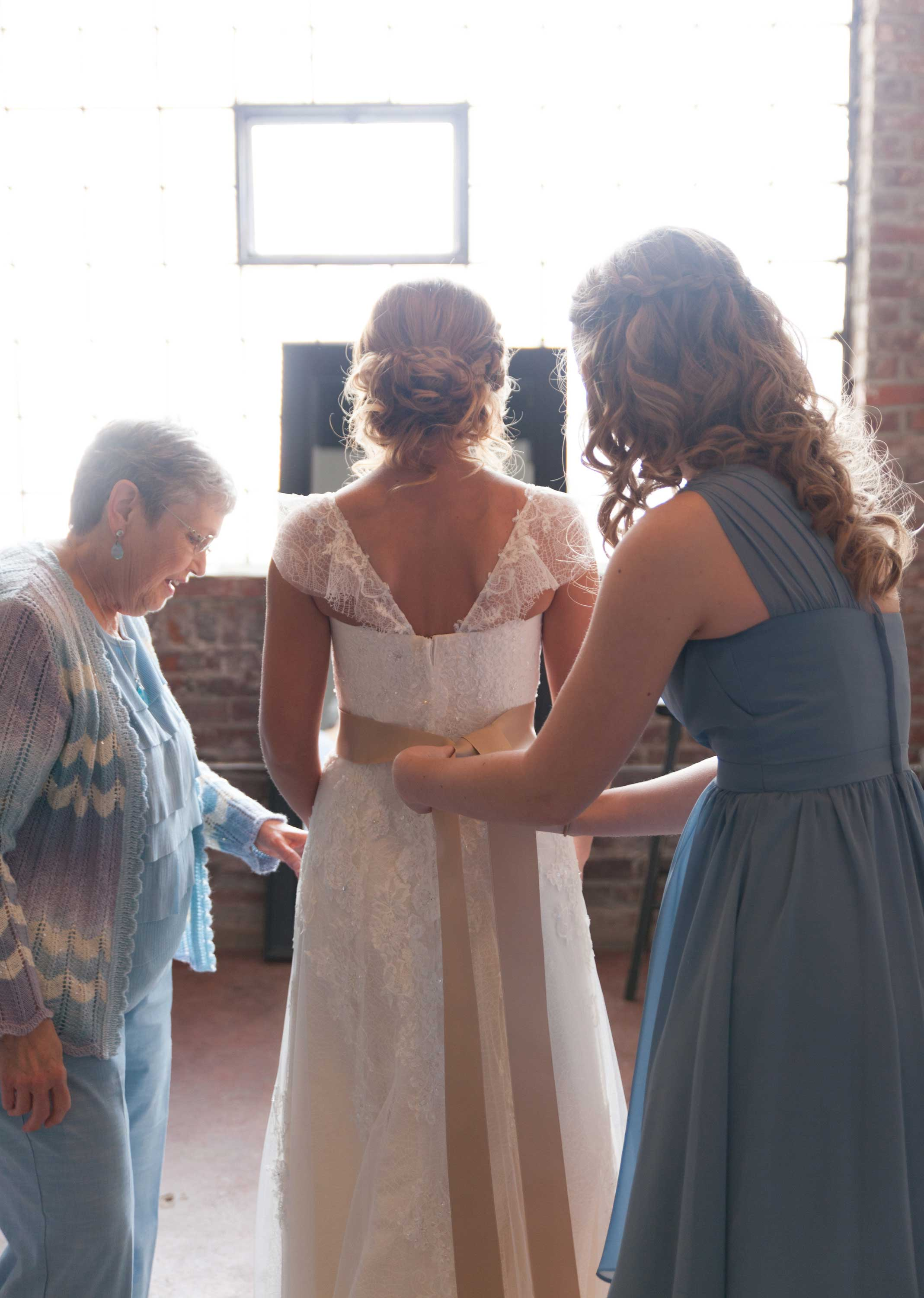 1. OUR BRIDE GETS HELP TYING HER SASH...