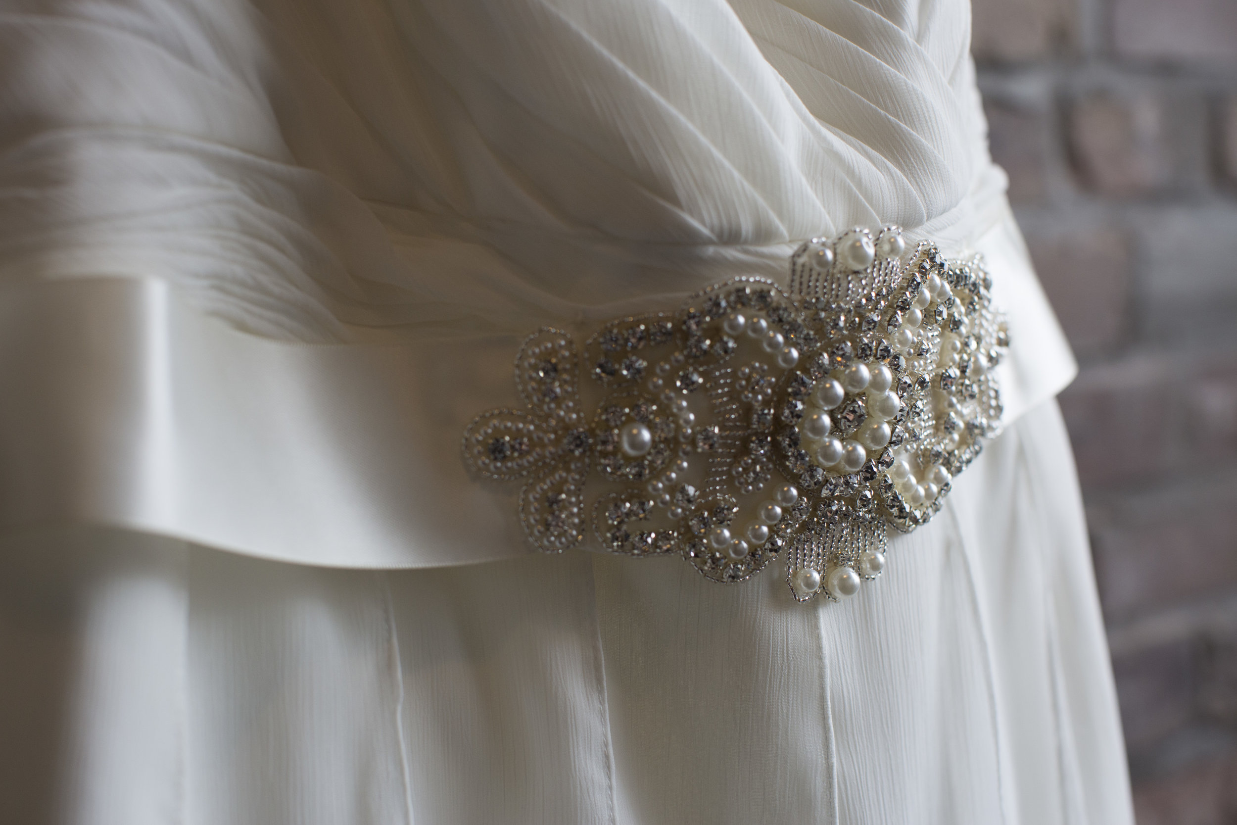 Carey added a touch of pearls & beads to her dreamy dress!