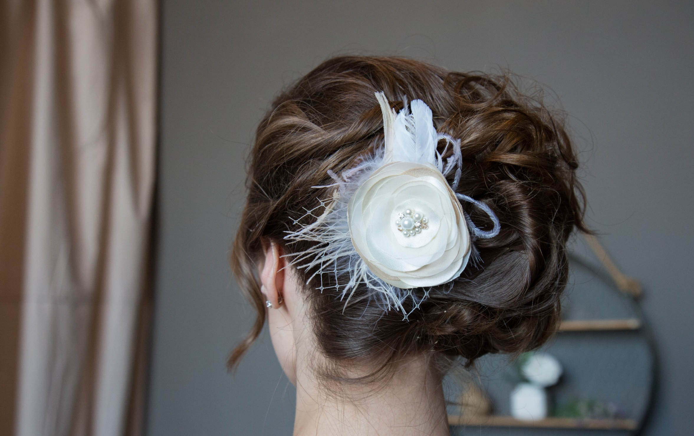 Amanda found the perfect little feathered hairpiece!