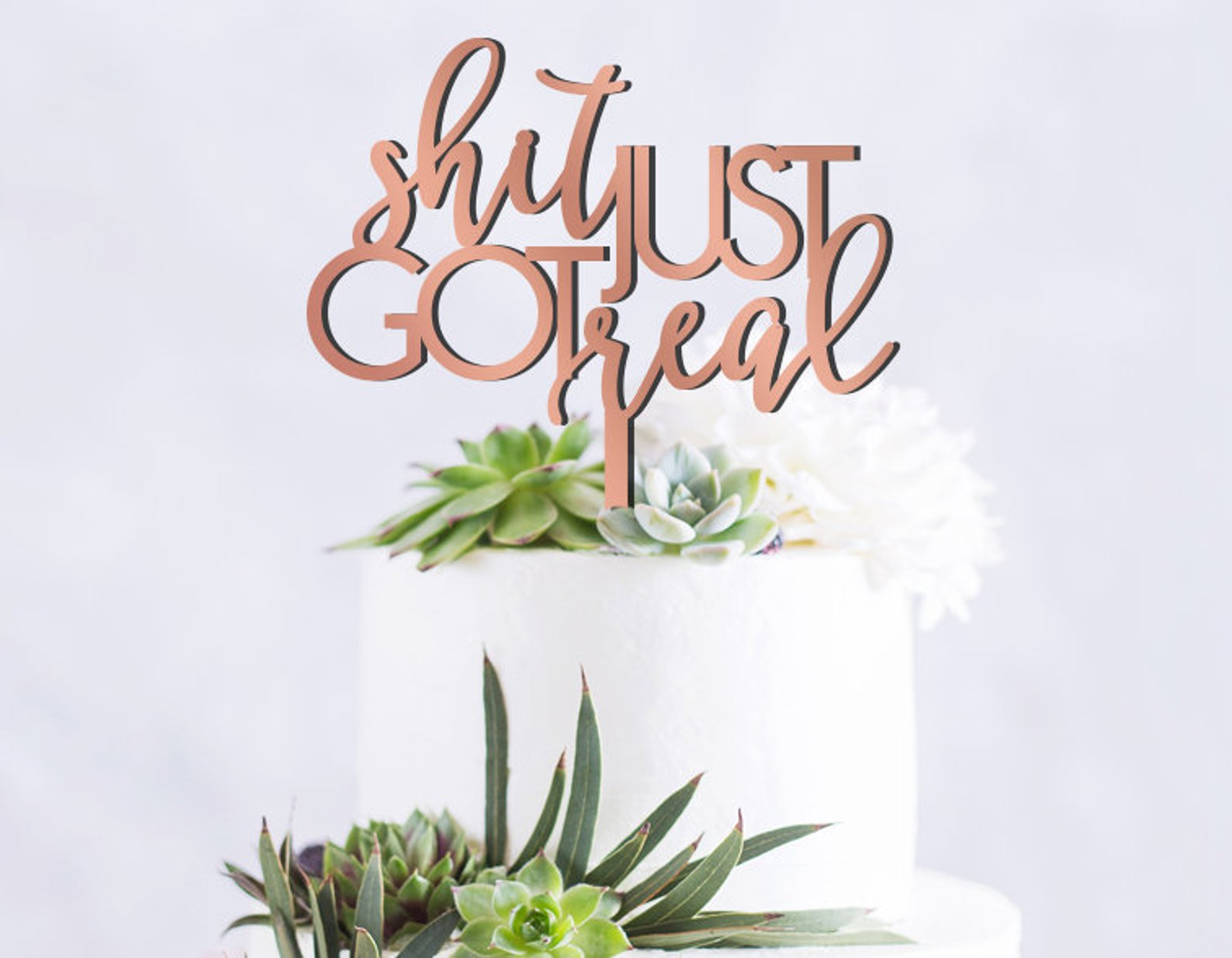 6. Just Got Real Cake Topper - Make all your guests laugh with this profane and to the point cake topper.