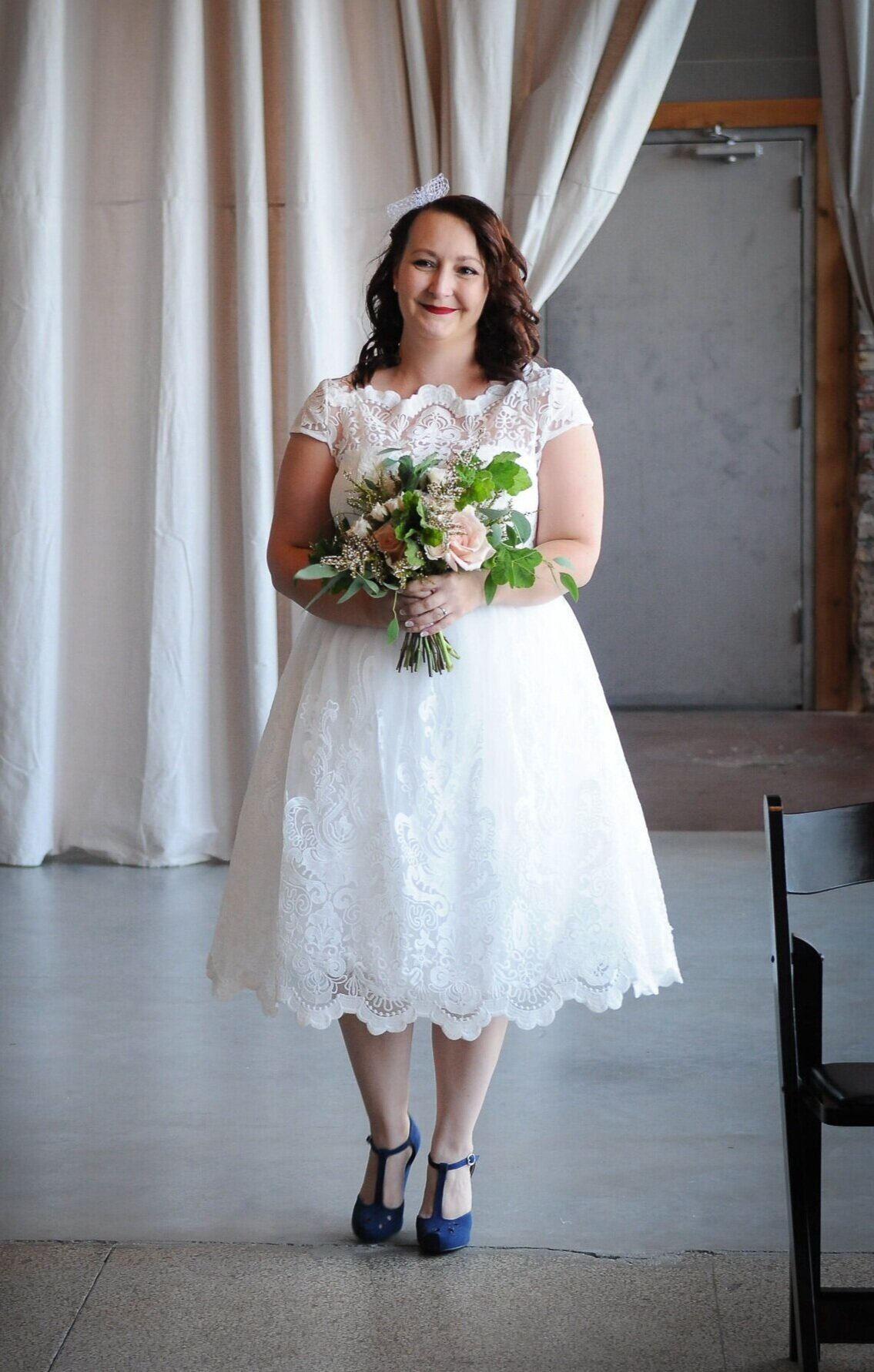 This old-school-cool bride, Heather, looks like she's bursting with happiness and she takes her solo walk down the aisle (in the most amazing vintage dress)!