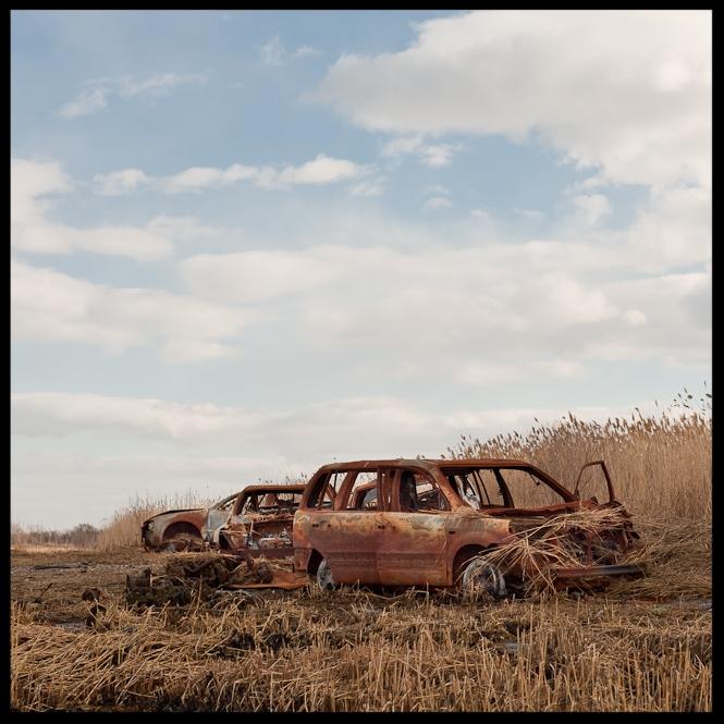 Discarded Cars on a Beach by Adrian Kinloch