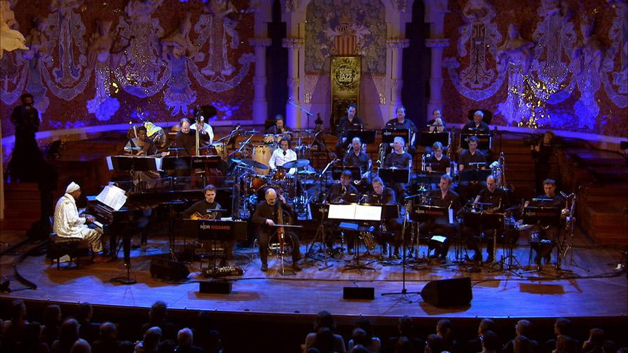 "Live with the NDR Big Band featuring Omar Sosa, Horacio ""El Negro"" Hernández and Jacques Morelenbaum at the ""Palau de la Música Catalana"" in Barcelona."