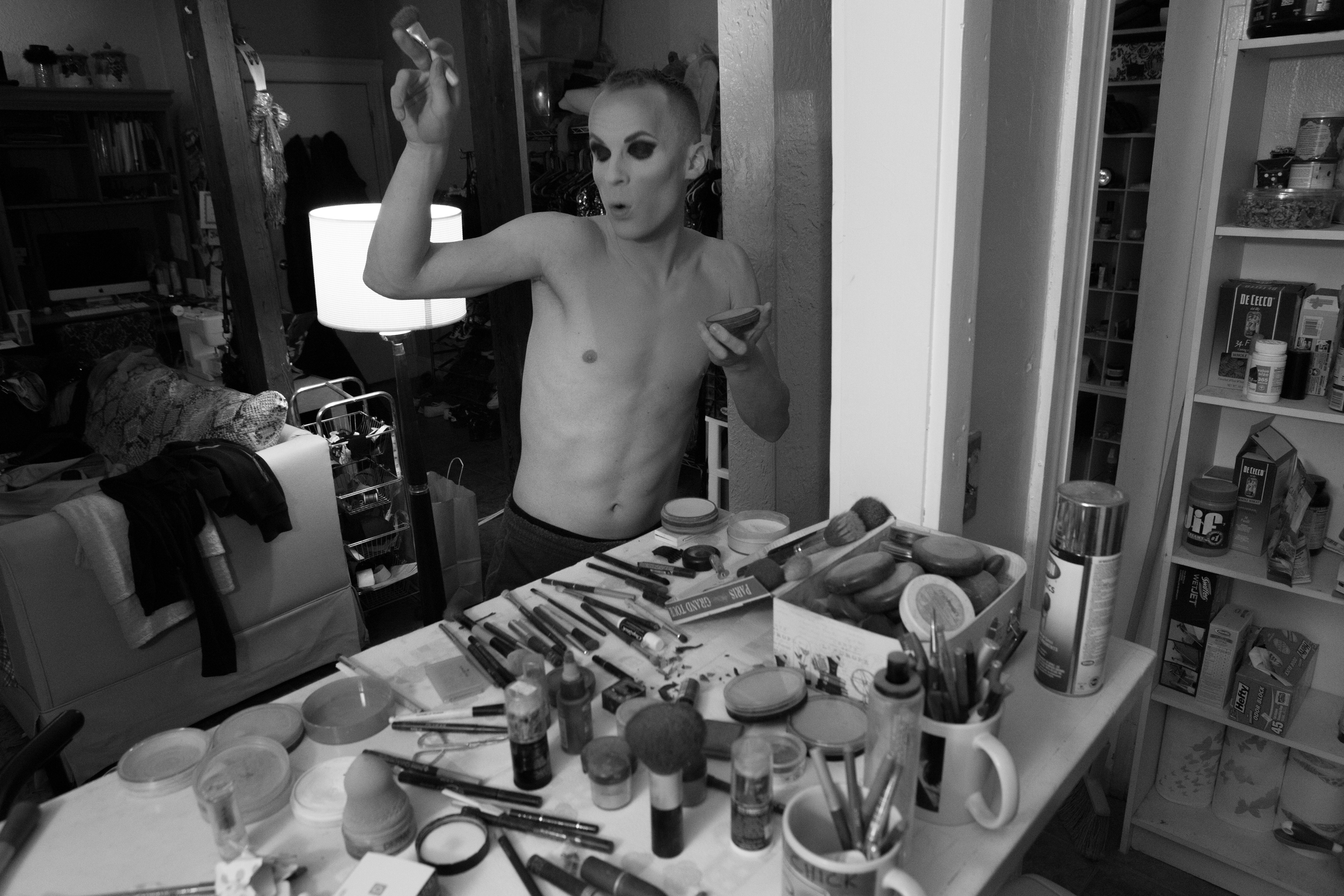 Brian McCook dances in his Broadway Street apartment in Boston, Mass. while applying makeup to dress in drag for a performance at Jaque's, a nearby bar that features entertainers in drag. Photo credit: Justin Saglio