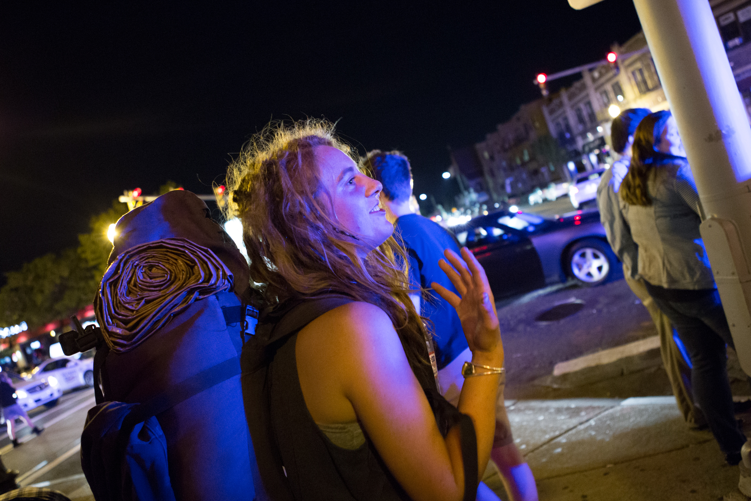 A 20-year-old homeless woman who asked to be identified as Toby reacts to police ordering her to leave the spot where she had been asking pedestrians for money and alcohol outside Blanchard's liquor store in Allston. Photo credit: Justin Saglio