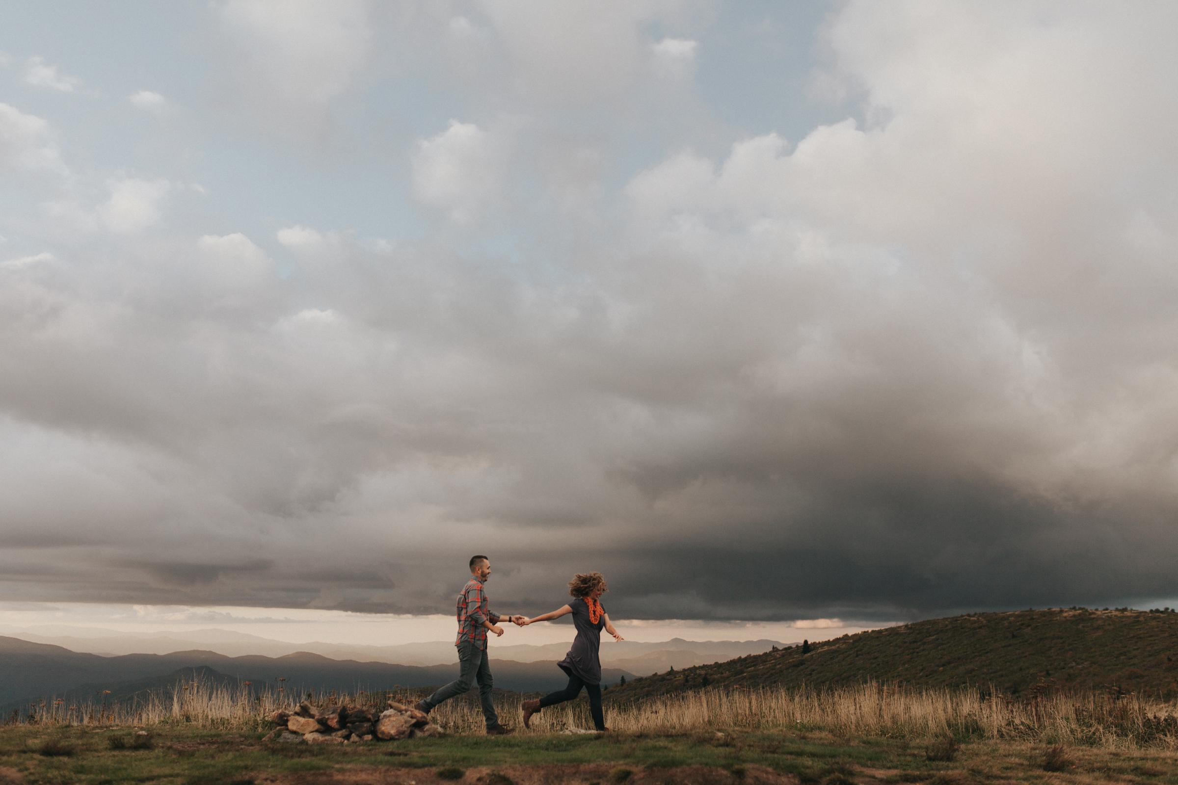 Couple runs through field on Black Balsam Mountain