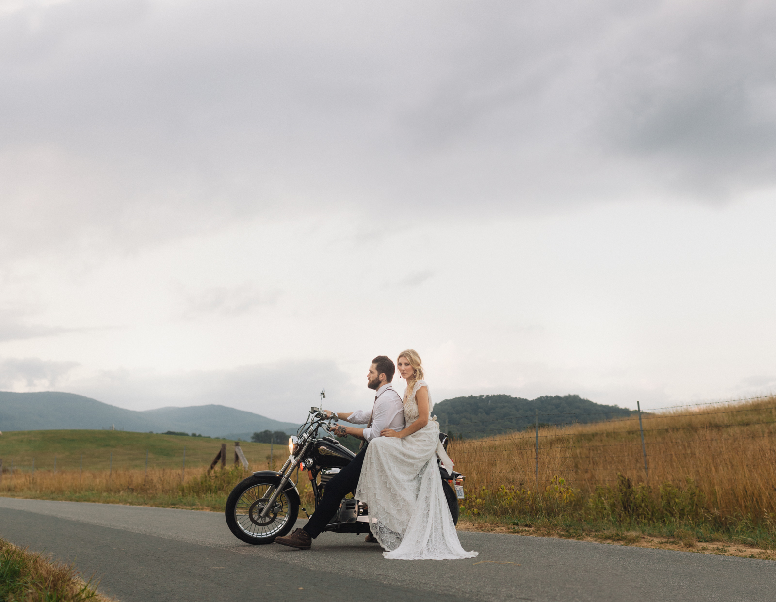 Couple on a motorcycle in the mountains of North Carolina on their wedding day.
