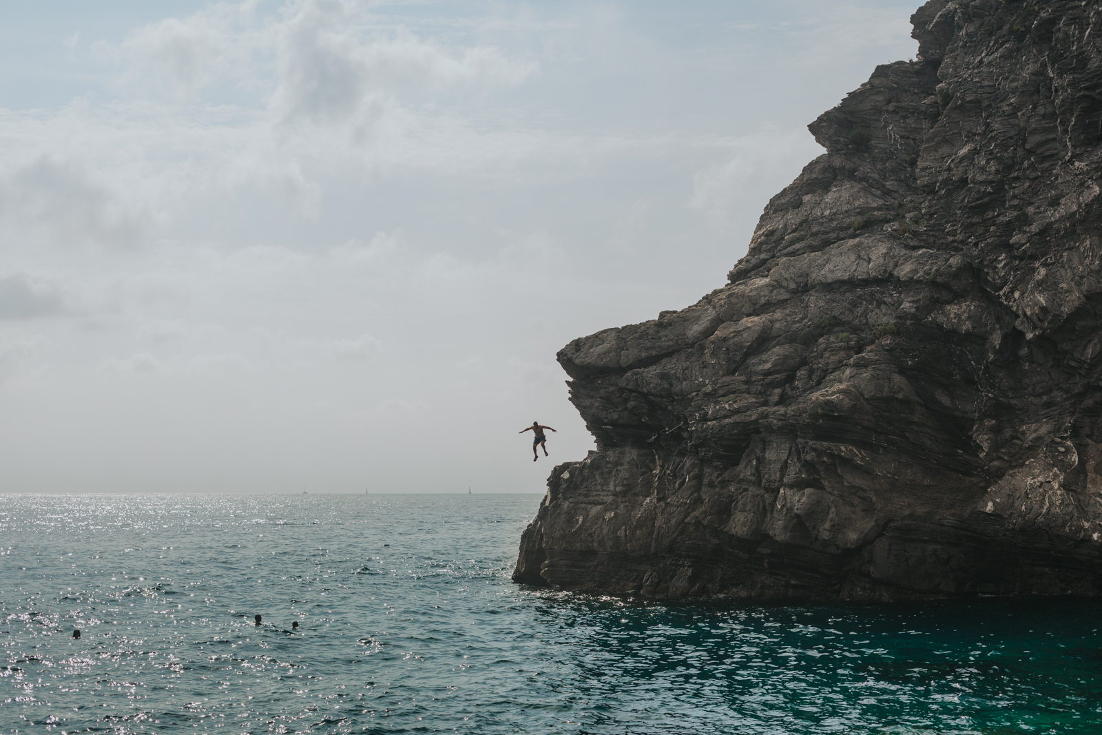 Cliff jumping in Cinque Terre, italy.