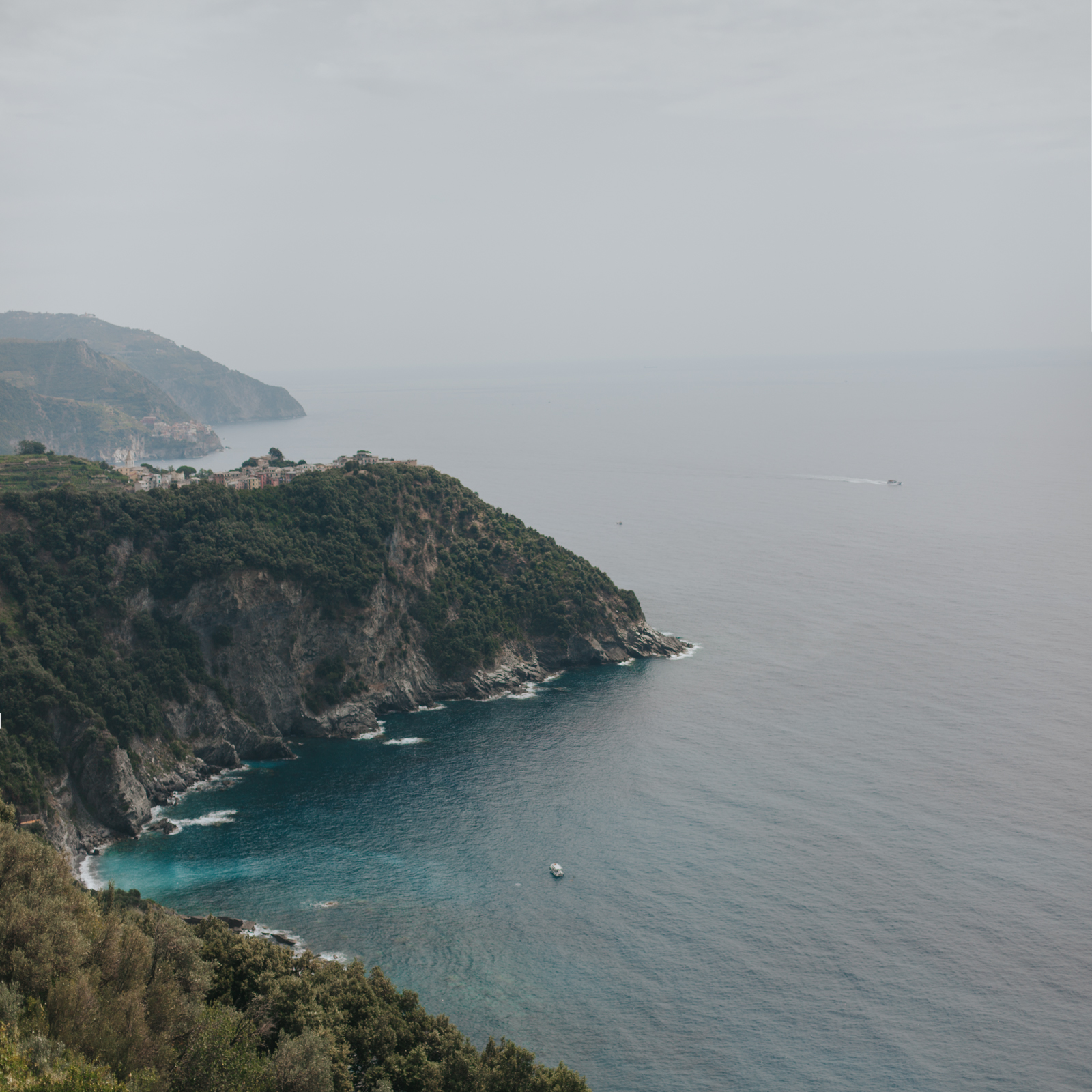 View of Corniglia, Italy from the hiking trail above the ocean.