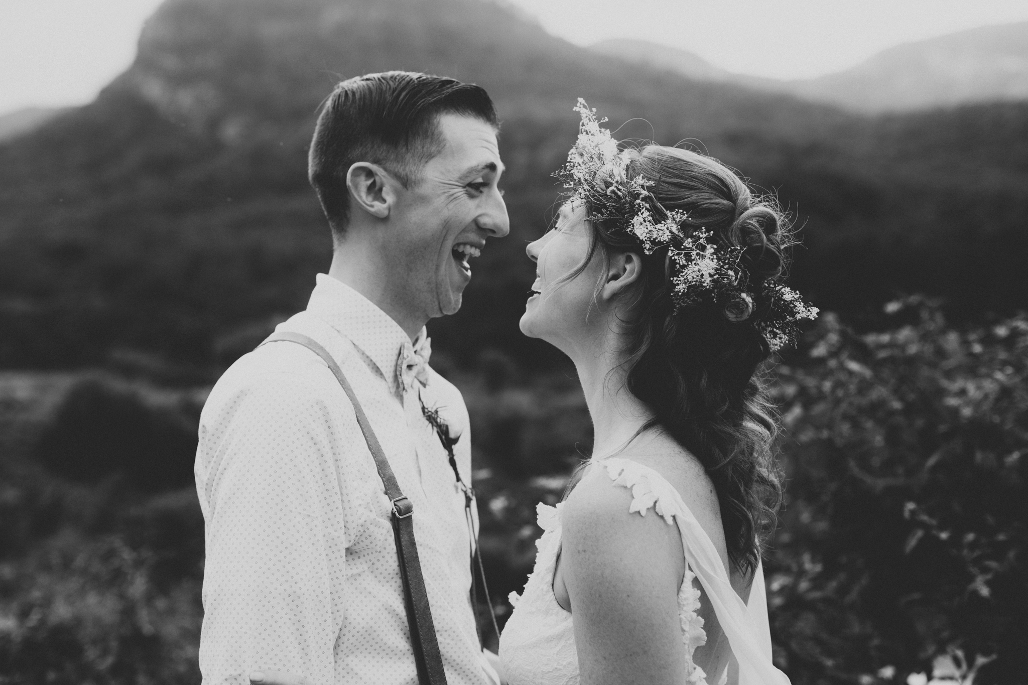 A couple laughs in after getting married at Lake Lure Inn outside of Asheville, NC.
