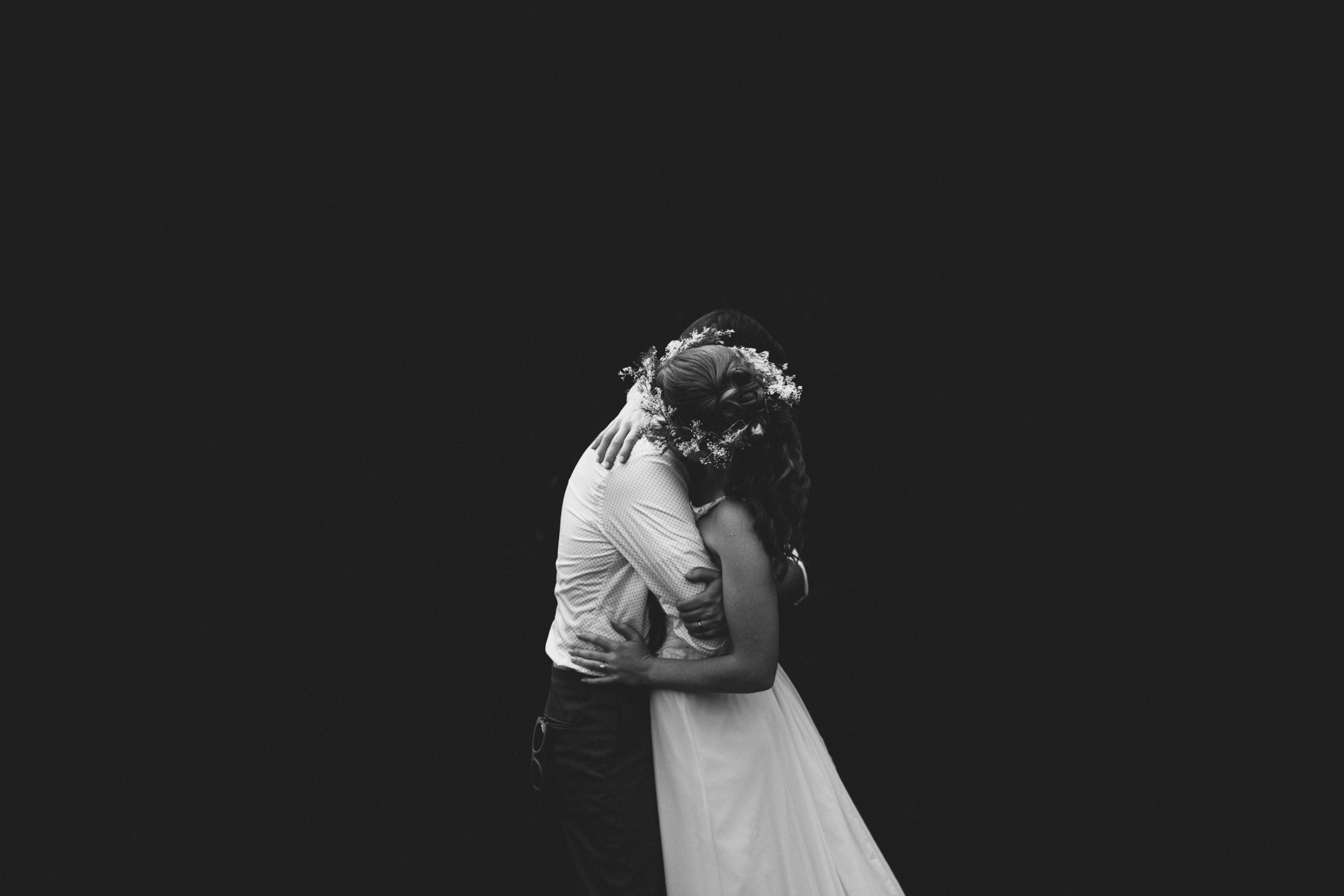Couple embraces during photos at a destination wedding at Lake Lure Inn, NC.