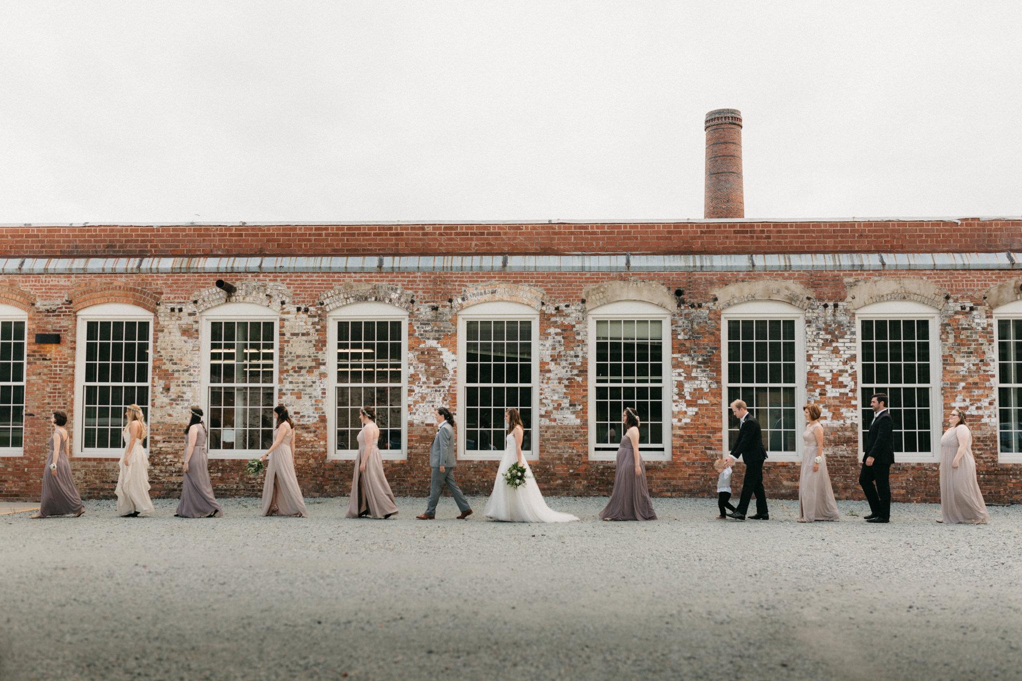 Bridal party at a same sex wedding at an old cotton mill in North Carolina.