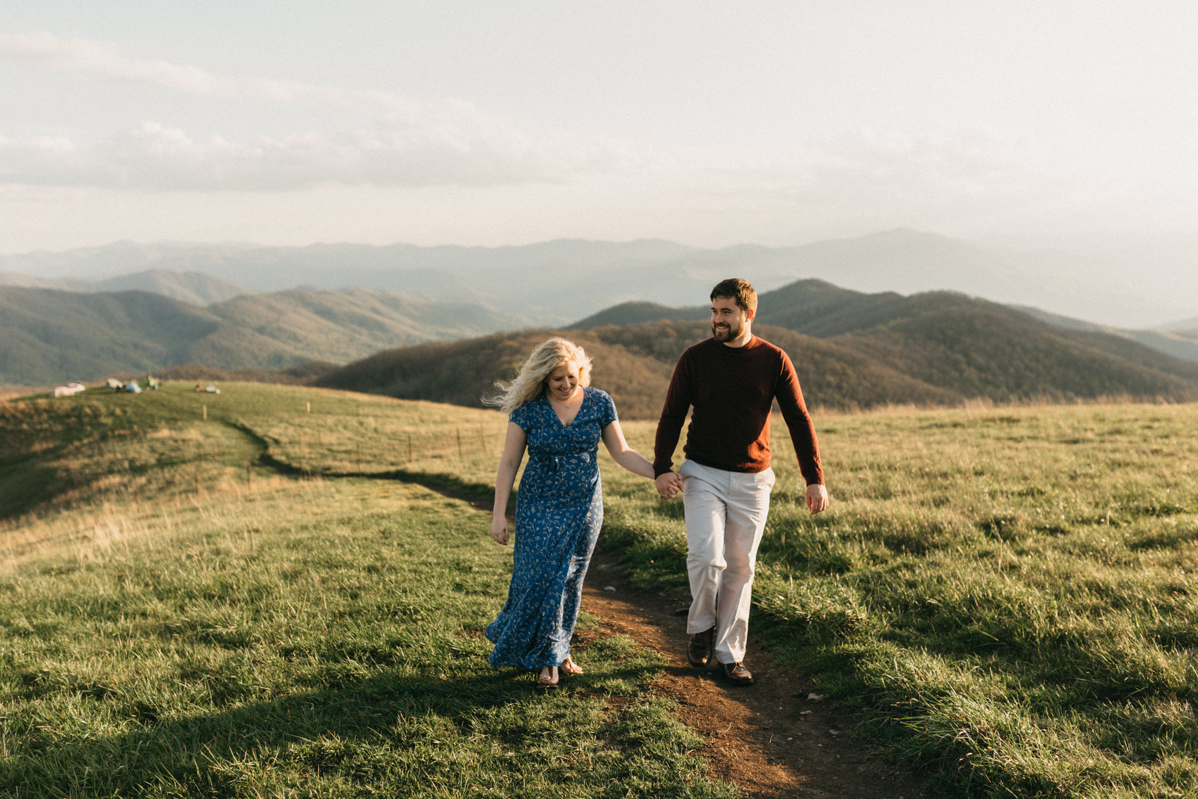 Bride and groom in the Blue Ridge Mountains during their candid, authentic engagement session.