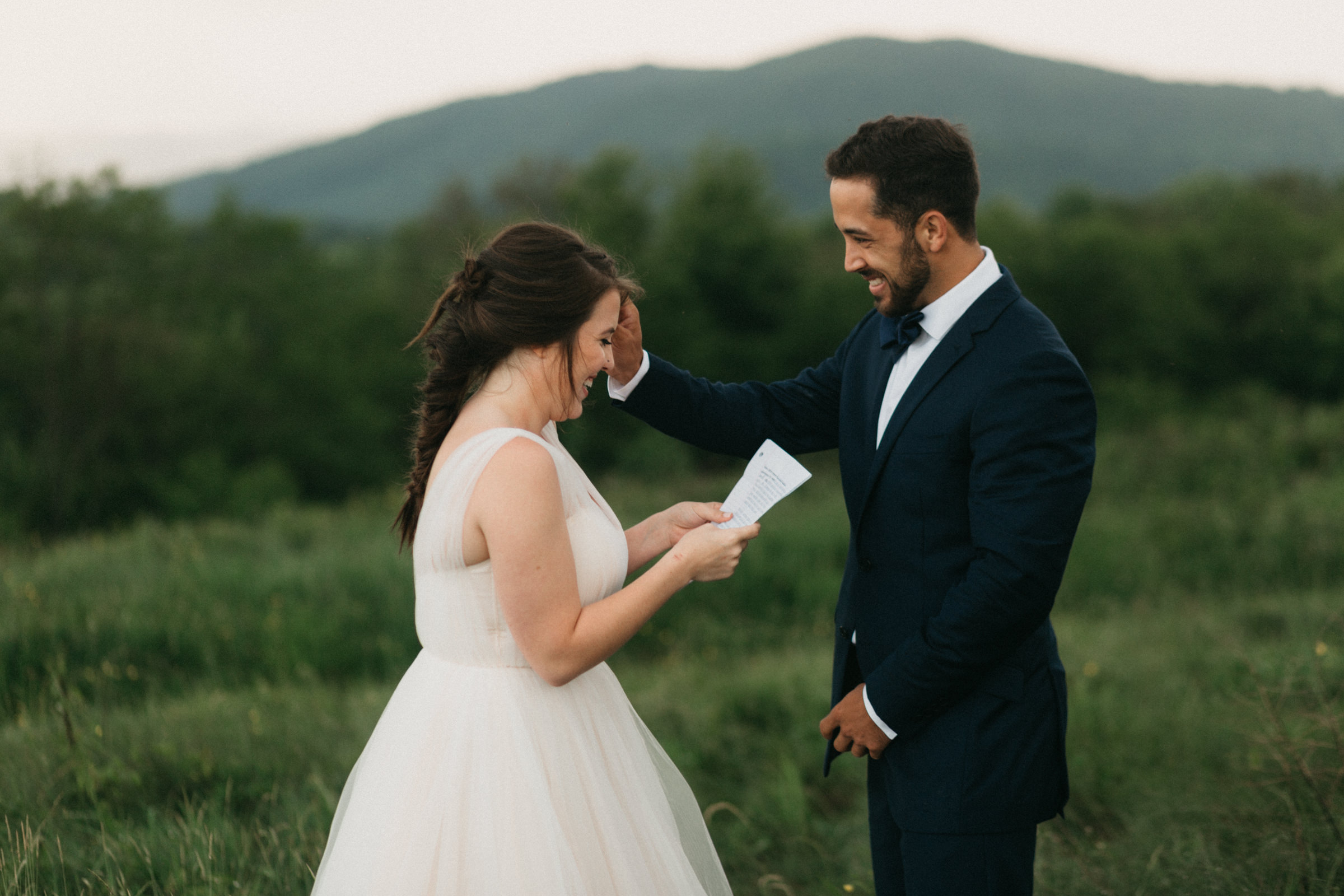 Bride and groom reading vows privately in a letter before they get married.