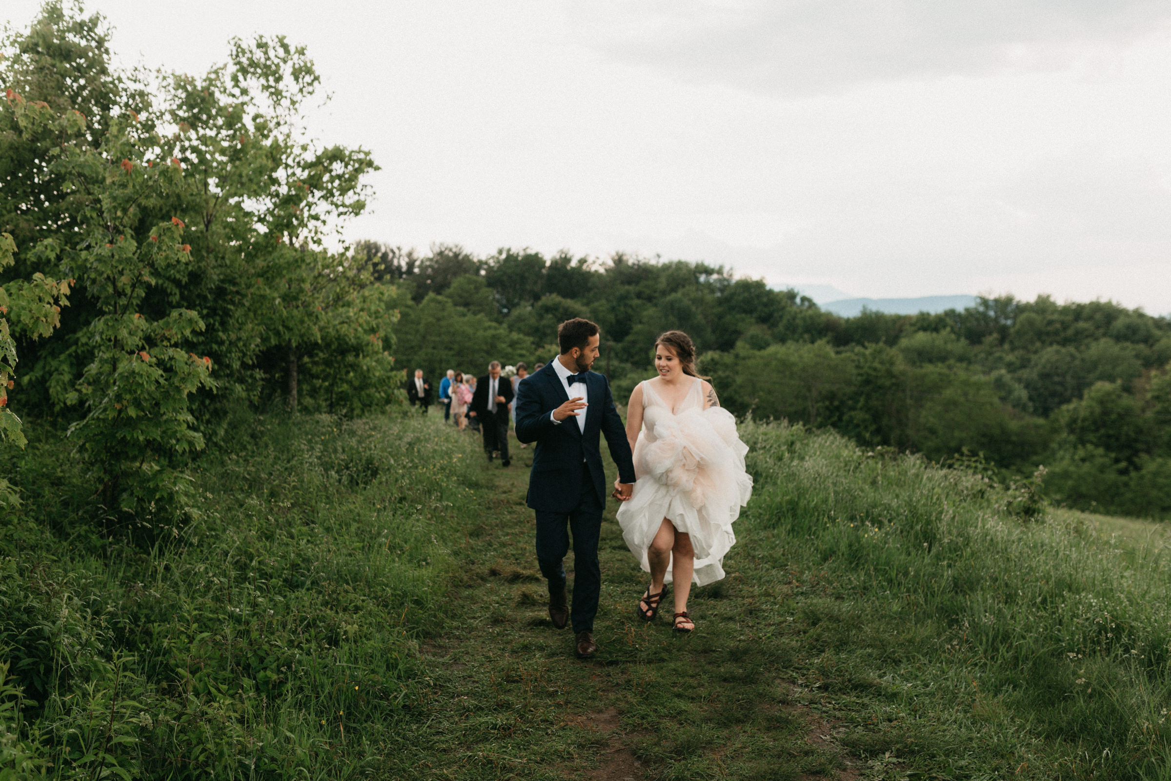 Bride and groom hike up to the top of the mountain to have their wedding on the Appalachian Trail.