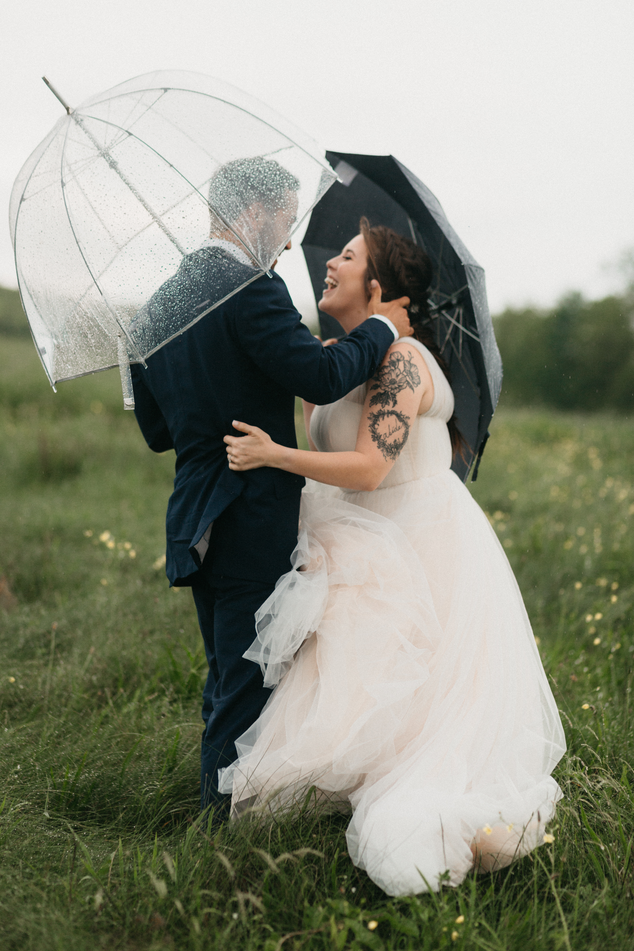 Rainy day couple shares a first look before their ceremony at Max Patch.