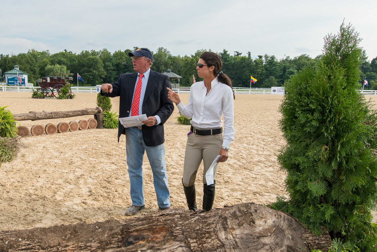 Jack Towell and daughter Liza Boyd walking the course during the 2013 USHJA International Hunter Derby Championship.