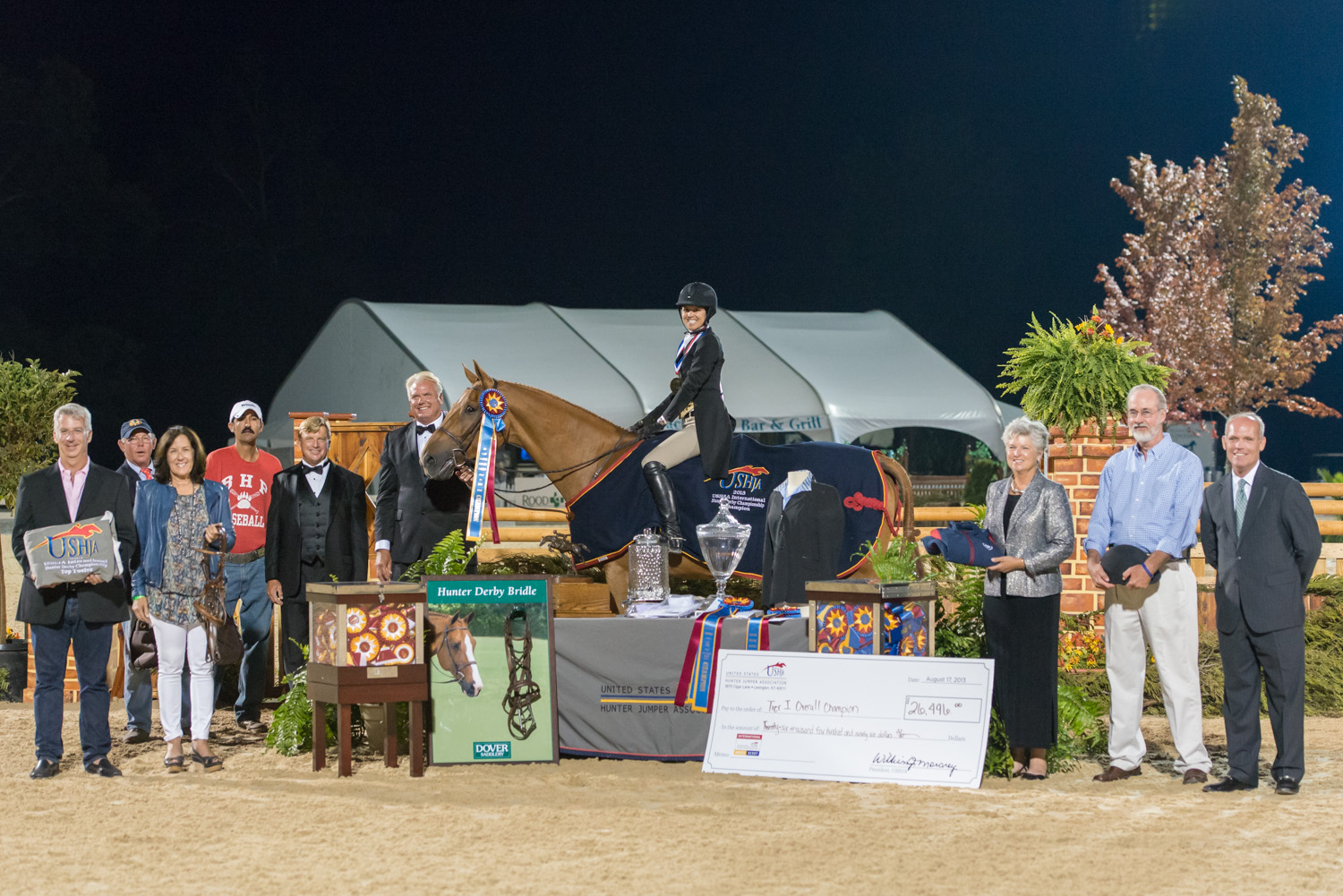 Liza Boyd and Brunello collect their awards during the 2013 USHJA International Hunter Derby Championship.