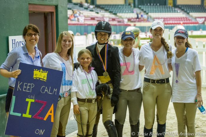 Liza Boyd and members of her fan club celebrate her 2013 WCHR Professional Finals victory.