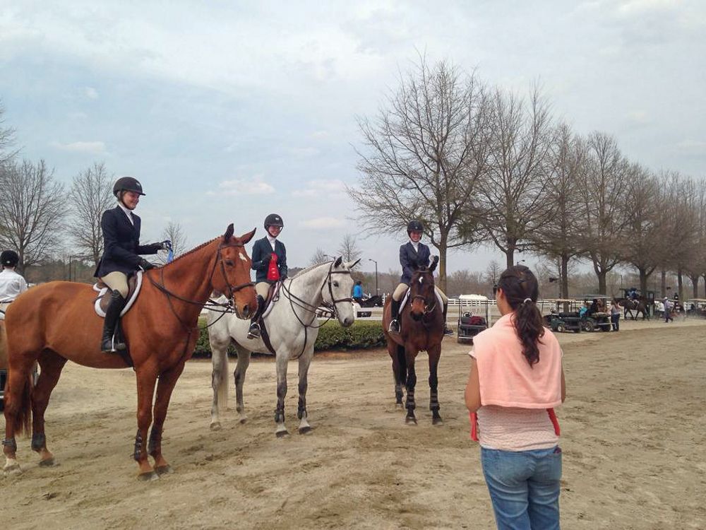 Trainer Liza Boyd and the Finally Farm equitation riders celebrate their USEF Medal performances.
