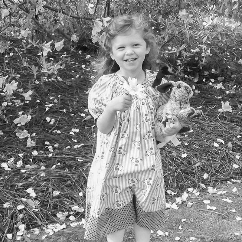 Elle Boyd enjoys spring flowers and her Easter Bunny.