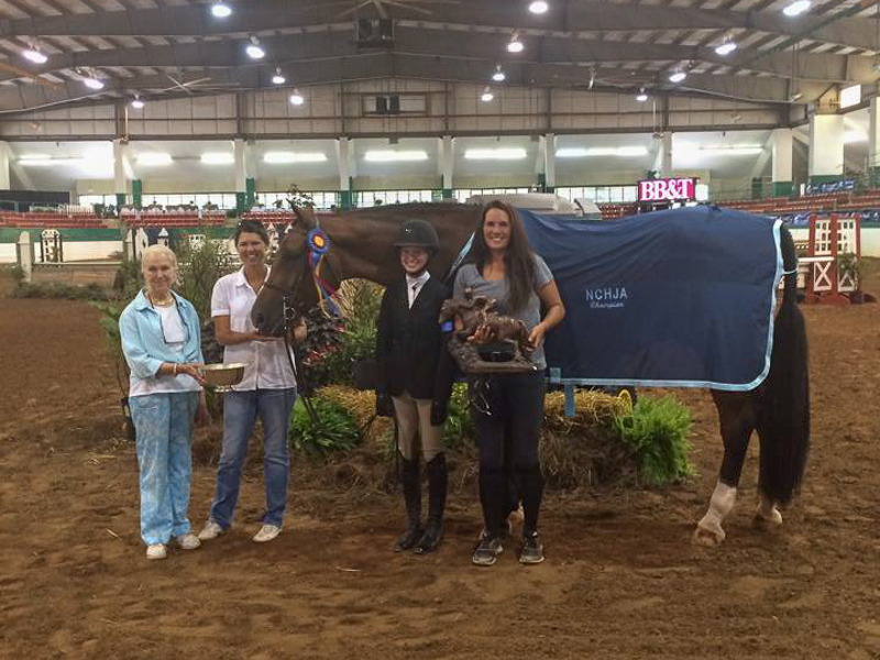 Grace Howard and Bethel's Peri collected the Grand Junior Hunter Championship at NCHJA.