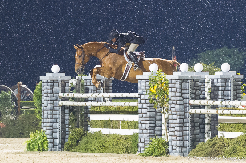 """Liza and Brunello fly over the final 4'8"""" oxer on the Handy Hunter course."""