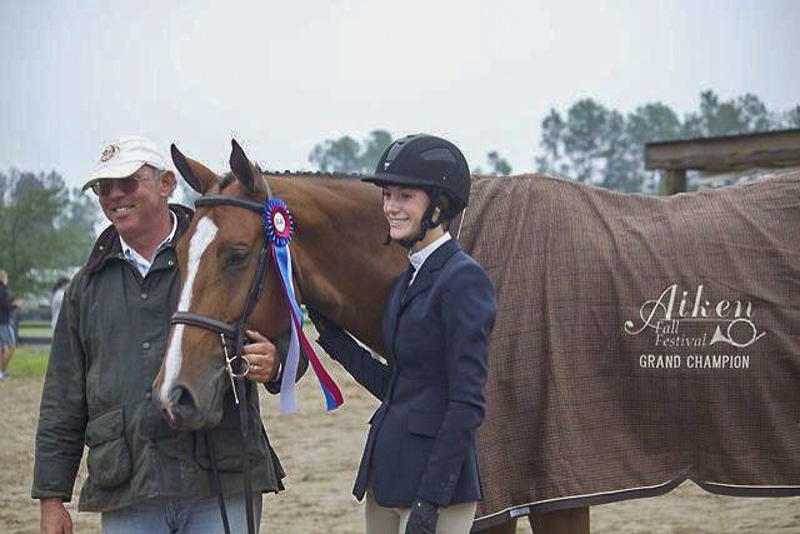 Trainer Jack Towell with Mary Carton Mitchener and the Grand Junior Hunter Champion Trinity.