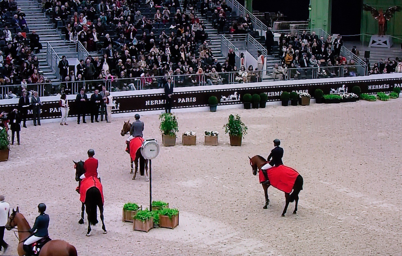 Hardin Towell, far right, waits to collect his second place aboard New York in the Prix GL Events class in Paris.