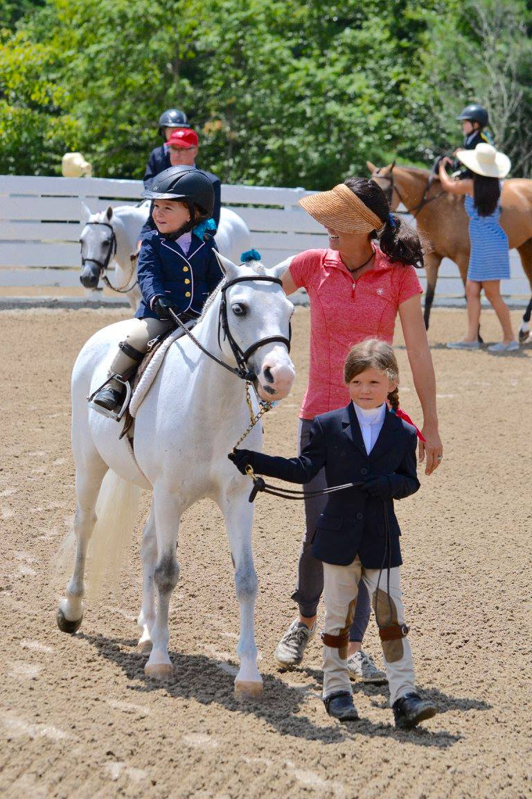 Adeline, riding, and Elle Boyd, leading,also shared the show ring spotlight with mother Liza, earning ribbons and making memories in the lead line and pony sections!